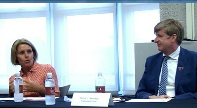 Amy Kennedy and Patrick Kennedy sit at a conference table