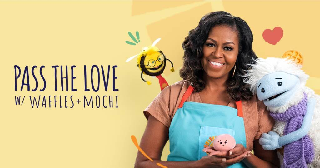 Michelle Obama is pictured with Waffles + Mochi in a promotional image for the 'Pass the Love' campaign
