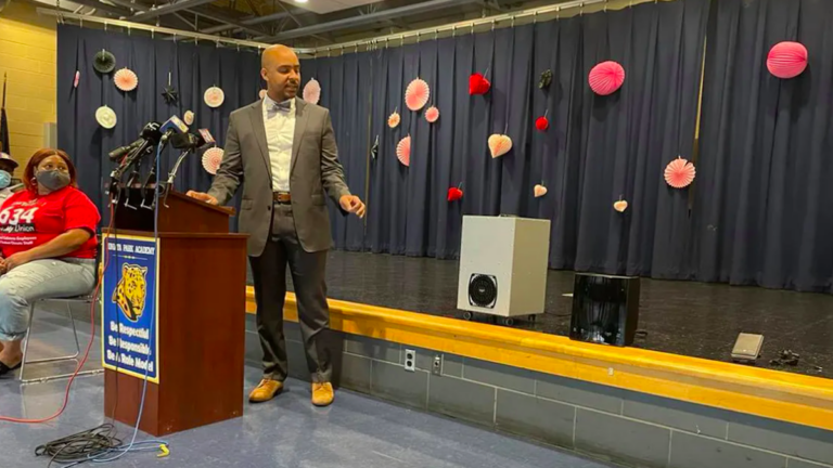 School District of Philadelphia Chief Operating Officer Reggie McNeil points to the district's new air and surface purifiers. Thursday's announcement was made at Juniata Park Academy in the lower Northeast. (Johann Calhoun / Chalkbeat)