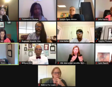Shown is Philadelphia's Board of Education during a virtual meeting. Angela McIver, left third row, announced her resignation at Thursday's meeting.  (Johann Calhoun / Chalkbeat)