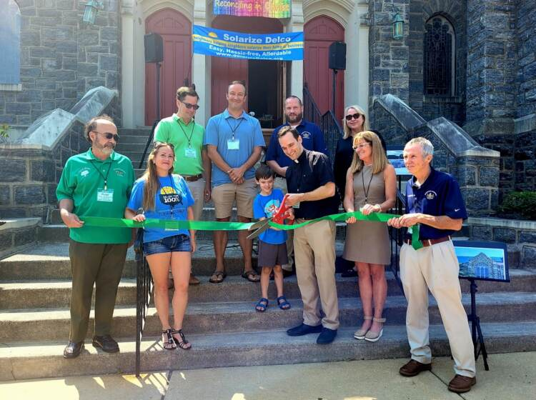 Solarize Delco's ribbon cutting. Left to Right: Peter Puglionesi, Melisa Romano, and Noel Smyth of Solarize Delco; Mike Zabel State Representative; Pastor Tim Johansen with son Leo; Colin Quinn VP Haverford Board of Commissioners; Francine Locke Del. Co. Director of Sustainability; Elaine Schaefer Del. Co. Council, Gerald Hart President Haverford Board of Commissioners. (Courtesy of Delaware County/Adrienne Marofsky)