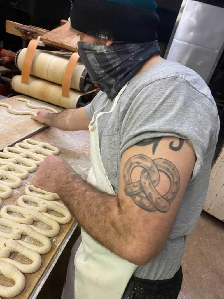 Anthony Panara hand-twists some pretzels