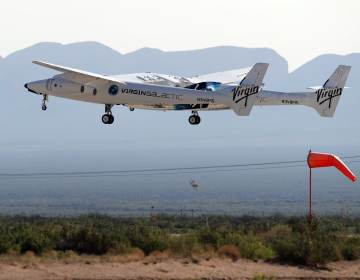 The rocket plane carrying Virgin Galactic founder Richard Branson and other crew members takes off