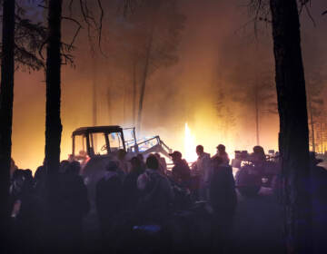 Volunteers prepare to douse a forest fire in the republic of Sakha