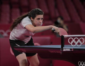 Syria's Hend Zaza competes during women's table tennis singles preliminary round match against Austria's Liu Jia at the 2020 Summer Olympics in Tokyo. (Kin Cheung/AP)