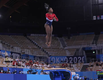 Simone Biles from the U.S. performs on the vault during the gymnastics