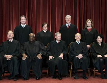 Members of the Supreme Court pose for a group photo at the Supreme Court in Washington