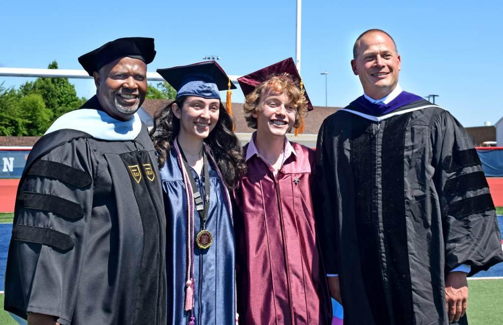 Eastern principal Dr. Robert Tull; salutatorian Arianna Reischer; Bryce Dershem; and Superintendent Robert Cloutier pose for pictures