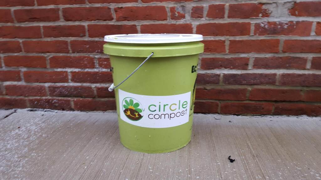 A compost bin sits on a Philadelphia sidewalk