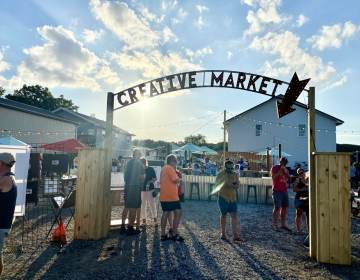 The Developing Artist Collaboration recently launched its open-air market in West Rehoboth to help local artists and other creative businesses. (Johnny Perez-Gonzalez/WHYY)