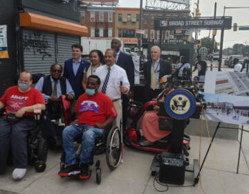 SEPTA Deputy General Manager Robert Lund, U.S. Reps. Dwight Evans and Brendan Boyle of Philadelphia, Liberty Resources CEO Tom Earle, and accessibility advocates for people with disabilities are pictured at a press conference