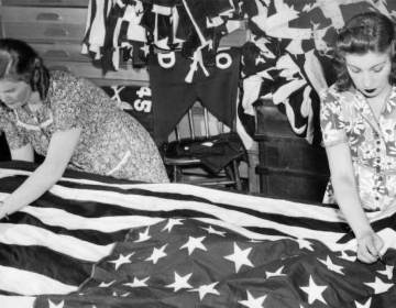 Grace Stanton stitches a large flag for the 1951 Fourth of July celebration in Fairmount Park PHILADELPHIA EVENING BULLETIN / TEMPLE UNIVERSITY ARCHIVES