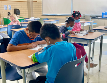 Students work on assignments during a summer school program at West Seaford Elementary School in Delaware. (Johnny Perez-Gonzalez/WHYY)