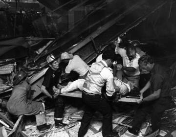 Firefighters rescue people from under a collapsed walkway in the lobby of the Hyatt Regency Hotel in Kansas City, Mo., on July 17, 1981. The collapse killed 114 people and injured more than 200. (Bettmann Archive/Getty Images)
