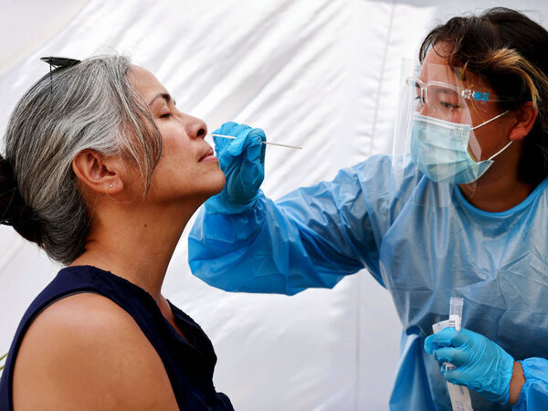A medical assistant administers a COVID-19 test