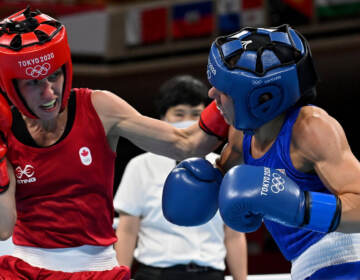Mandy Bujold (L) of Canada exchanges punches with Nina Radovanovic of Serbia