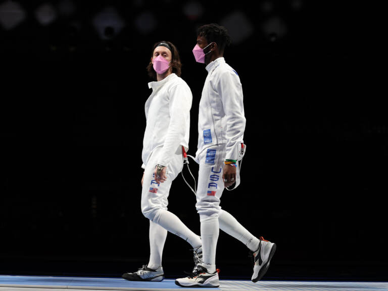 American's Jacob Hoyle and Curtis McDowald wear pink face masks after losing to Japan in Men's  Épée. (Elsa/Getty Images)