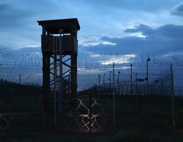 Razor wire and a guard tower stands at a closed section of the U.S. prison at Guantánamo Bay on Oct. 22, 2016. (John Moore/Getty Images)