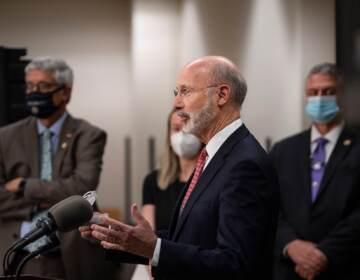 Pennsylvania Gov. Tom Wolf speaks from a podium