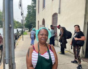 Joanne Matthews of the Emmanuel Dining Room exhorted people in line to get the shot. (Cris Barrish/WHYY)