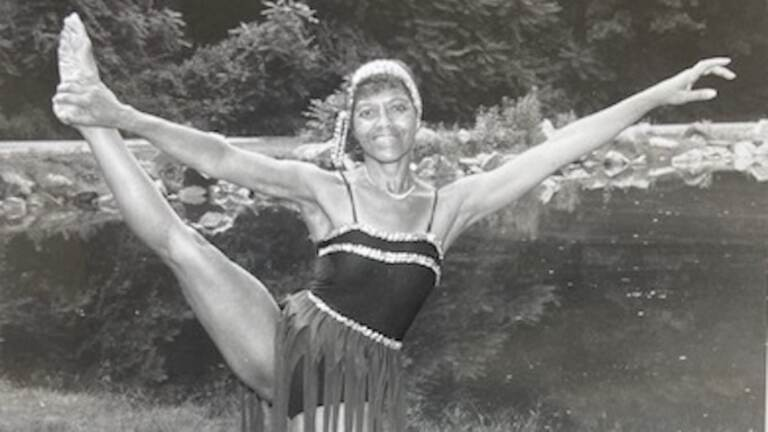 Dancer lone Nash holds her leg in the air