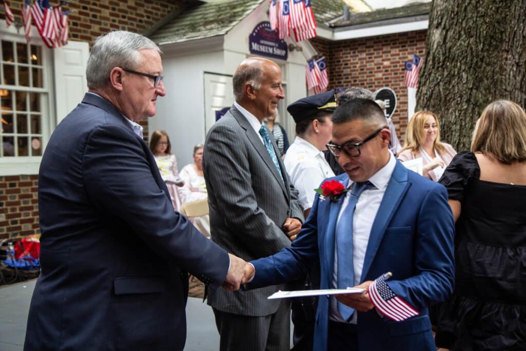 Gonzalo Ramirez shakes hands with Mayor Jim Kenney