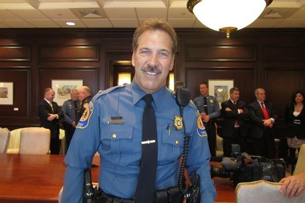 Michael Capriglione wearing a police uniform
