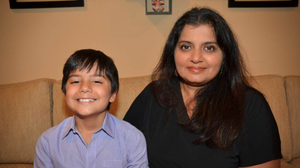 Purnima Montagne sits with her son Thejas