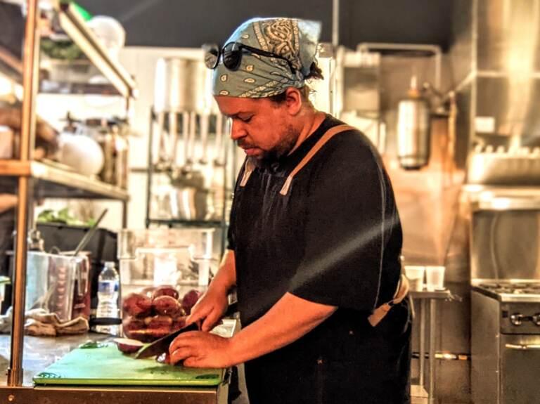 Lamar Cornet works inside a restaurant