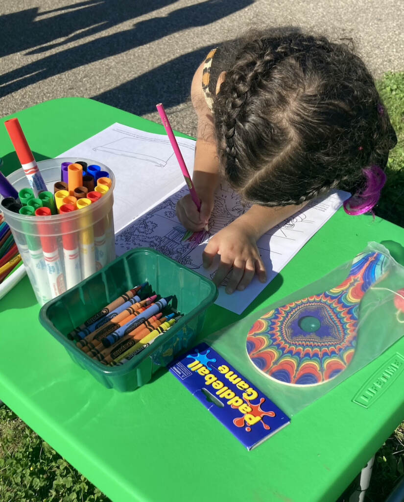 A child colors in the Seedlings coloring book.