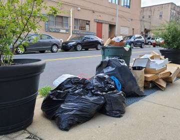 Trash sits on a Philly sidewalk.
