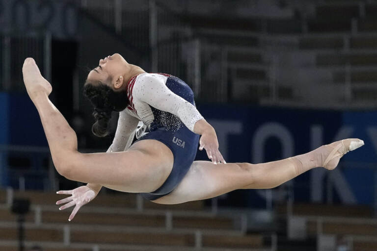 Sunisa Lee, of the United States, performs on the floor during the artistic gymnastics women's all-around final at the 2020 Summer Olympics, Thursday, July 29, 2021, in Tokyo. (AP Photo/Gregory Bull)