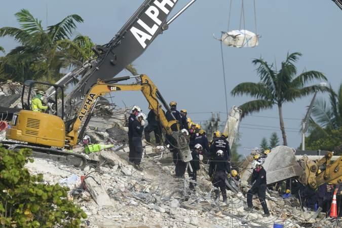 Rescue crews work at the site of the collapsed Champlain Towers South condo building