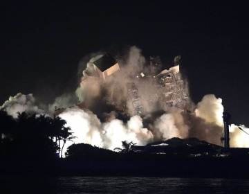 The remaining structure of the Champlain Towers South condo building is demolished