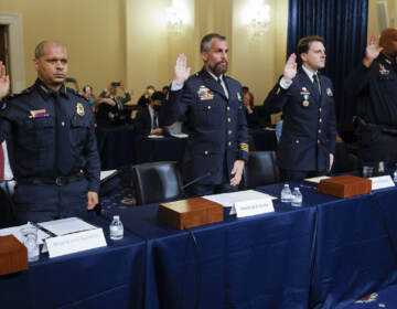 U.S. Capitol Police sergeant Aquilino Gonell; Washington DC Metropolitan Police Department officers Michael Fanone and Daniel Hodges, and U.S. Capitol Police Officer Harry Dunn are sworn in to testify during the opening hearing of the U.S. House (Select) Committee investigating the January 6 attack on the U.S. Capitol, on Capitol Hill in Washington, U.S., July 27, 2021. REUTERS/Jim Bourg/Pool