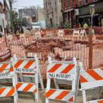 A gaping hole at 6th and Bainbridge streets is closed off by Philly Streets Department barriers