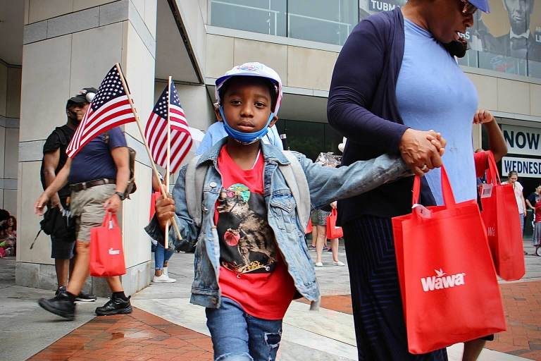 Naeem Townsend leaves the National Constitution Center with a hat, a flag, and a hoagie, giveaways