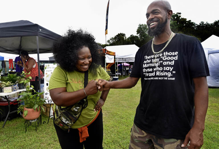 Two people pose at grand opening of Mask Melanin Market in Glassboro.