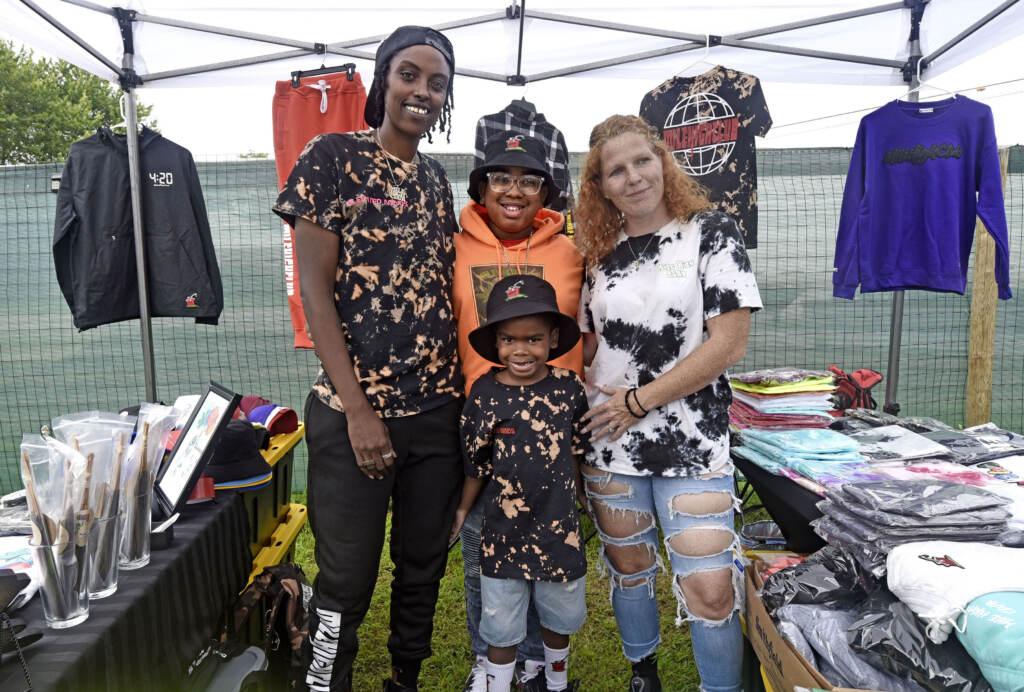Family poses at grand opening of Mask Melanin Market.