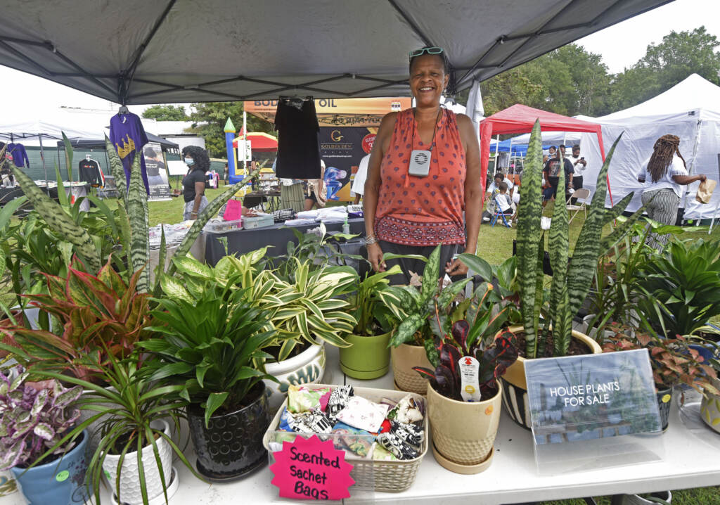 Vendor stands at booth at grand opening of Mask Melanin Market in Glassboro, NJ.