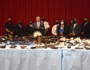 New Jersey Acting Attorney General Andrew Bruck with several law enforcement officials announcing the results of a gun buyback that took place in three counties. (P. Kenneth Burns/WHYY)