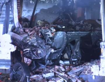 Wreckage after car crashed into house.