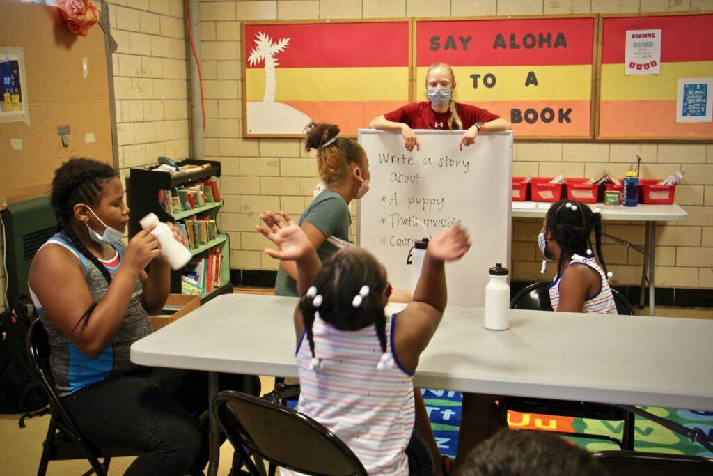 Emily Rankin gives her class at McVeigh Recreation Center a writing prompt