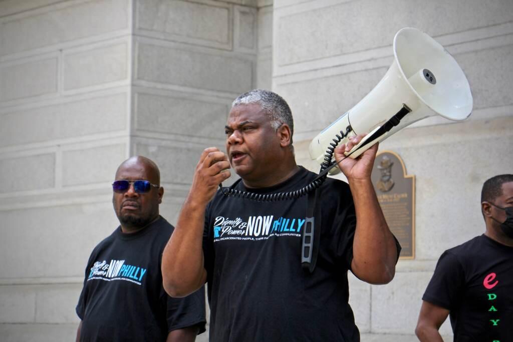 Reuben Jones speaks into a bullhorn