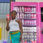 Emani Outterbridge holds up yarn in front of one of her vending machines