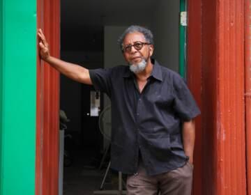 James Dupree stands in the doorway of his Queen Village gallery
