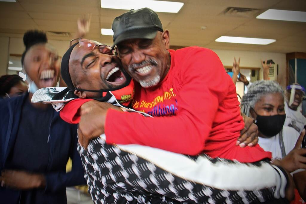 Trenton Track Club coaches (from left) Nigeil Boone and Al Jennings embrac