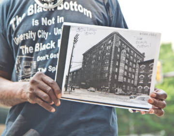 Andre Black holds a photo of Philadelphia's Black Bottom neighborhood