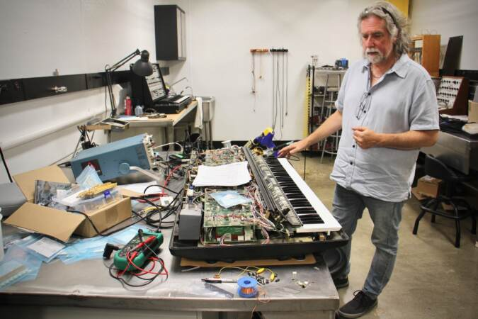 Drew Raison shows a disassembled Polymood keyboard