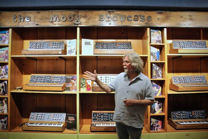 Drew Raison leads a tour of the Moog showcase room